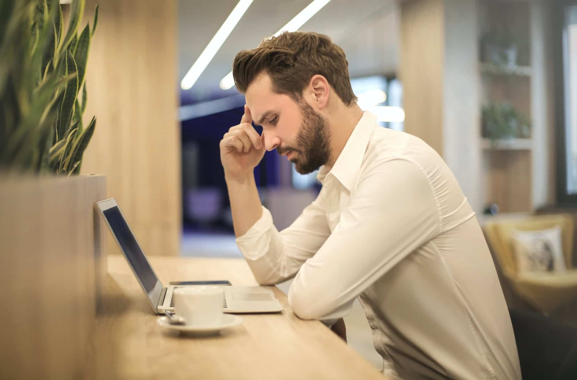 Man Thinking what blogging niche he should focus on